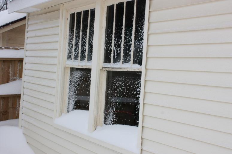 Snow Dust on Garage Windows